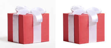 Gift box decorated silk red ribbon and bow, object on white studio background Royalty Free Stock Photo