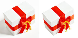 Gift box decorated silk red ribbon and bow, object on white studio background Stock Image