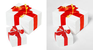 Gift box decorated silk red ribbon and bow, object on white studio background Stock Photos