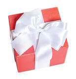 Gift box decorated silk red ribbon and bow, object on white studio background isolated Stock Images