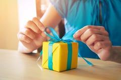 Gift box decorating with ribbon. Woman making gift box decorating with ribbon Stock Photography