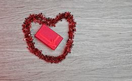 Gift box with heart-shaped decoration stock photos