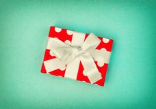 Gift box decoration turquoise background vintage toned. Gift box decoration on turquoise background. Vintage style toned picture royalty free stock photography