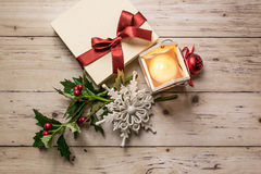 Gift box with decoration on wooden background Royalty Free Stock Images