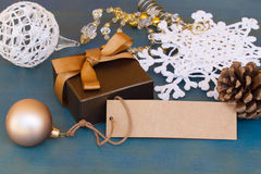 Gift box with decorations and empty tag Stock Images
