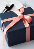 Gift box in a decorative red ribbon Royalty Free Stock Photos