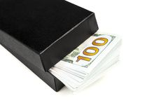 Gift box with dollar bills. Black box sticks out bundle of dollar bills isolated on white background Stock Photos