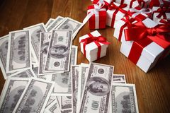 Gift box with dollar on wooden.  Royalty Free Stock Photography