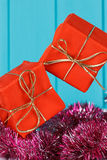 Gift box with dots floating in the air over blue background Stock Images