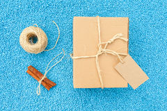 Gift box in eco paper on blue stone background Stock Photography