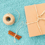 Gift box in eco paper on blue stone background Royalty Free Stock Photography