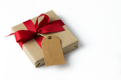 Gift box with empty tag Royalty Free Stock Photography