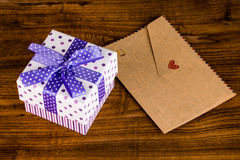 Gift box and envelope Royalty Free Stock Images
