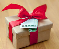 Gift box with  euro banknote Stock Photo