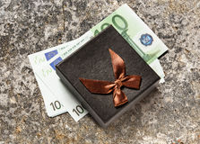 Gift box with euro banknotes Royalty Free Stock Images