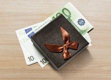Gift box with euro banknotes Stock Photos