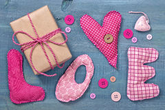 Gift box and fabric letters Stock Photos