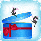 Gift box with fairies Stock Images