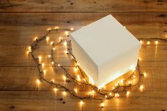 Gift Box and Fairy Lights Royalty Free Stock Image