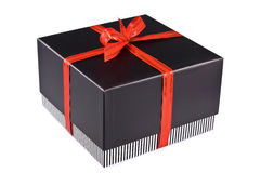 Gift box fastened by a red tape Royalty Free Stock Photography