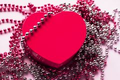 Gift box on the festive background. Red heart. Valentine`s Day gift royalty free stock images