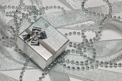 Gift box with festive decor. Ribbons and beads Royalty Free Stock Photography