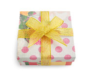 Gift box with festive floral and polka dot prints Royalty Free Stock Photo