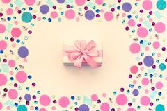Gift box on festive pastel background. Flat lay top view Royalty Free Stock Images