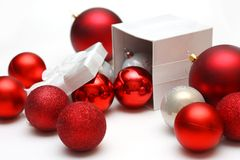 Gift Box Filled with Christmas Ornaments Stock Images