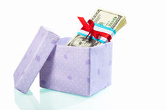 Gift box filled with US dollar bills. Isolated on white Royalty Free Stock Images