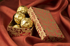 Gift box. Floral gift box of chocolates. Red Valentines day, birthday or celebration background Royalty Free Stock Photos
