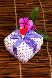 Gift box and flower Royalty Free Stock Image