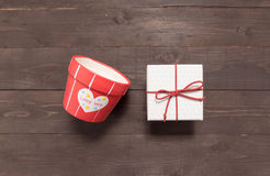 Gift box and flower pot are on the wooden background with empty Royalty Free Stock Images