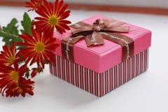 Gift box with flowers. Gift box with flowers on the white background Stock Photos