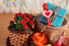 Gift box with flowers on the basket. Royalty Free Stock Photo