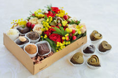 Gift box with flowers and candies made of chocolate Stock Photography