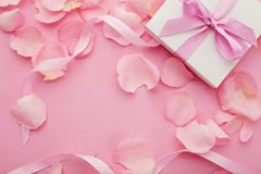 Gift box and flowers. Gift box and pink rose petals, copy space royalty free stock photos
