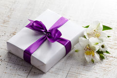 Gift box and flowers Royalty Free Stock Photo