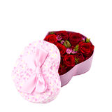 A gift box with flowers. Red roses in a pink box in the shape of a heart Stock Photography