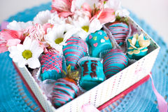 Gift box with flowers and strawberry and banana covered by light Royalty Free Stock Photo