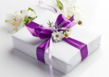Gift box and flowers Stock Photos
