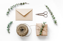Gift box with flowers on white background top view. Gift box with flowers for holiday on white table background top view Royalty Free Stock Photos