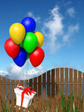 Gift box flying with ballons Stock Photos