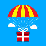 Gift box flying on parachute, delivery service, bonus concept. F Stock Images