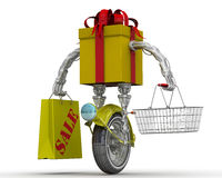 Gift box in the form of a robot on the wheel with food basket and shopping bags. Yellow gift box in the form of a robot on a wheel with a grocery basket and Stock Photos