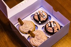 Gift box of four delicious homemade cupcakes stock image