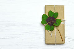 Gift box with four leaf clover Stock Image
