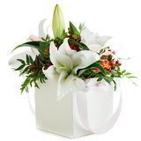 Gift box with fresh lily flowers and chrysanthemum isolated on w. Hite background stock photography
