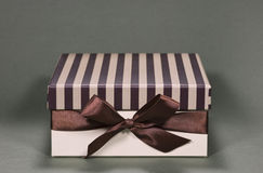 Gift box, front view. Gift box on green background, front view Royalty Free Stock Photos