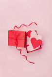Gift box full of hearts on pink background for Saint Valentines Day, top view Stock Photography